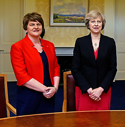 File photo dated 25/7/2016 of Arlene Foster (left), leader of the Democratic Unionist Party, with Prime Minister Theresa May. Talks between the Tories and the Democratic Unionist Party were continuing on Wednesday amid reports that any announcement of a deal may be delayed because of the tragic fire in a London tower block.