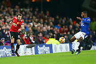 Juan Mata of Manchester United (l) passes the ball past Cuco Martina of Everton . Premier league match, Everton v Manchester Utd at Goodison Park in Liverpool, Merseyside on New Years Day, Monday 1st January 2018.<br /> pic by Chris Stading, Andrew Orchard sports photography.