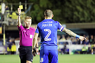 AFC Wimbledon defender Barry Fuller (2) yellow card during the EFL Sky Bet League 1 match between AFC Wimbledon and Milton Keynes Dons at the Cherry Red Records Stadium, Kingston, England on 22 September 2017. Photo by Matthew Redman.