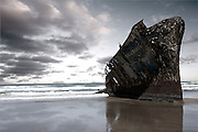 The ship Jacaranda came onshore under suspicious circumstances many years ago. Day by day it slowly erodes as the elements wear down the steel hull. Image by Greg Beadle Greg Beadle catches a fresh angle on interesting subjects. Art photography by Beadle Photo