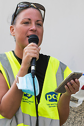 London, UK. 20th July, 2021. Katie Leslie of the PCS trade union addresses fellow members working for the outsourced contractor ISS on the picket line outside their workplace at the Department for Business, Energy and Industrial Strategy (BEIS) on the second day of a 3-day strike. The striking cleaners, security guards and other support staff at the government department are demanding an end to low pay, improved working conditions, bonuses for having worked through lockdown, annual leave from last year and a Covid return-to-work protocol.