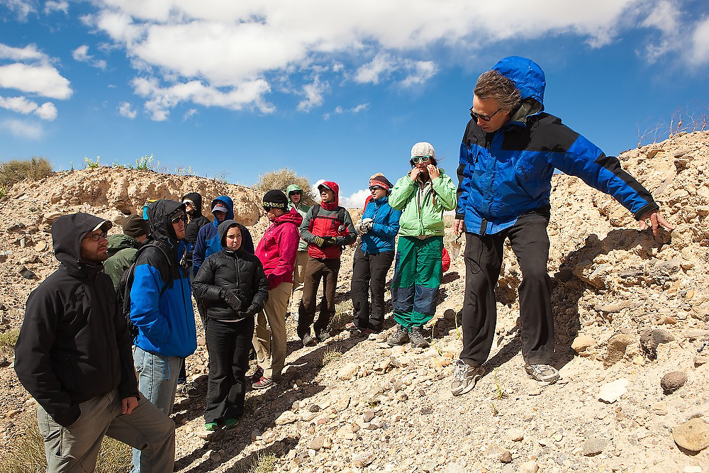 Geomorphology professor Robert Anderson lectures his students on a field trip with the University of Colorado standing on the Fremont River terraces near Hanksville in Southern Utah.