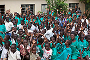 Children at Nyamiyaga primary school where the Bwindi Community Hospital run health outreach programs.  At the end of the visit the children are waving them off. As part of the outreach programme they cover 32 primary schools and 5 secondary schools in the region as well as many communities. The main Bwindi Community Hospital is in Buhoma village on the edge of the Bwindi Impenetrable Forest in Western Uganda. It serves around 60,000 people from the surrounding area.