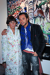 Artist SACHA JAFRI and his mother SUZIE JAFRI at a private view of Sacha Jafri's paintings entitled 'London to India' held in aid of The Elephant Family charity at 23 Macklin Street, Covent Garden, London on 3rd June 2010.