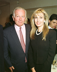 MR & MRS ROBERT SANGSTER, he is the racehorse owner, at a party in London on 7th May 1997.LYE 45