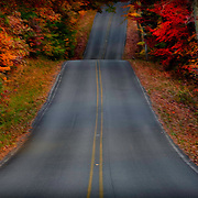 Road through the rolling hills atop Alabama's Lookout Mountain, framed by autumn foliage.