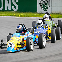 Cameron Edwards (Repco MK1) leads James Straker (Elfin Crusader) and Daniel Gate (Vixen MK01) through Turn 1 at Wanneroo Raceway during the Formula Vee WA State Title round hosted by the WA Sporting Car Club.