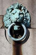 Decorative mooring rings adorn the walls along the River Thames near Blackfriars Bridge