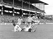 Two Down player fall to the ground as Dublin steals possession of the ball during the Kerry v Dublin All Ireland Senior Gaelic Football Final in Croke Park on the 24th of September 1978. Kerry 5-11 Dublin 0-9.