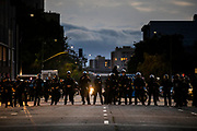 OAKLAND, CA - MAY 29: Oakland Police officers form a line in front of the Oakland Police Department Headquarters as demonstrators approach during protests against the  death of George Floyd in police custody, in Oakland, California on May 29, 2020. (AP Photo/Philip Pacheco)