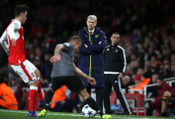 Arsenal manager Arsene Wenger looks dejected during the UEFA Champions League Round of 16, Second Leg match at the Emirates Stadium, London.