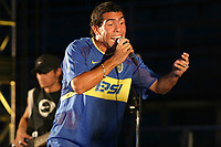 Fotball<br /> Argentina<br /> Foto: Digitalsport<br /> Norway Only<br /> <br /> 03.04.2004<br /> Boca 99 birthday in Boca Juniors Stadium,  Buenos Aires, Argentina<br /> During the BOCA jrs Aniversary Party CARLOS TEVEZ was playing with his musical group. TEVEZ still with his NIGHT LIFE like when he did not was yeat a proffesional player