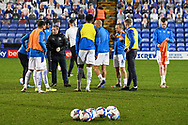Tranmere players warm up during the EFL Sky Bet League 2 match between Tranmere Rovers and Forest Green Rovers at Prenton Park, Birkenhead, England on 19 January 2021.