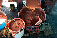 The press makes bucket-fulls of guava pulp during the process of making Guyaba bars (Florida, Camagüay Province, Cuba).
