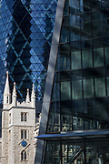 The Swiss re tower (top left, aka The Gherkin) and the church of St. Mary Axe in the City of London, the capital's historic financial district, on 2nd August 2018, in London, England.