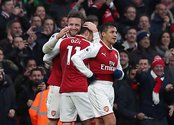 Arsenal's Shkodran Mustafi (left) celebrates scoring his side's first goal of the game during the Premier League match at the Emirates Stadium, London.