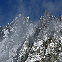 Winter spindrift blows off Inconsolable Range near Bishop Pass.