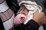France. Refugees. Calais. So-called Jungle camp . A two week old baby whose parents are from Iran.