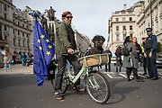 A man on a bicycle with a European Union flag and a dog in the basket joins pet owners to take part in an anti Brexit Wooferendum rally on October 07, 2018 in London, England to protest against Britain leaving the European Union.