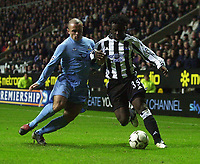 Photo. Glyn Thomas.Digitalsport<br /> Newcastle United v Tottenham Hotspur. FA Barclaycard Premiership. St James' Park, Newcastle. 13/12/2003.<br /> Newcastle's Titus Bramble (R) holds off a challenge from Stephen Carr.