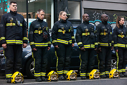 London, UK. 14th June, 2018. A guard of honour prepared by the London Fire Brigade for the Grenfell Silent March through West Kensington on the first anniversary of the Grenfell Tower fire. 72 people died in the Grenfell Tower fire and over 70 were injured.