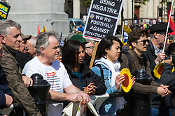 London, May 1st 2015. Hundreds of workers and Trade Unionists from across the UK are joined by Turks, Kurds and anti-capitalists as they march through London on May Day. PICTURED: Workers listen to speeches by trade Unionists.