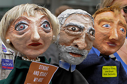 "© Licensed to London News Pictures. 02/06/2017. London, UK. Papier mache puppets depicting Theresa May, Jeremy Corbyn and Tim Farron on display. Demonstrators gather outside the BBC headquarters in protest against the Corporation for not playing the song ""Liar Liar"" by Captain Ska on BBC Radio 1.  Organised by The People's Alliance, people carried signs bearing an image of Prime Minister Theresa May with the words ""Liar Liar"" and ""You Can't Trust Her"" on each side.    Photo credit : Stephen Chung/LNP"