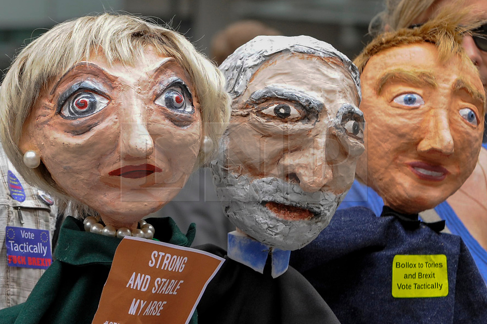 """© Licensed to London News Pictures. 02/06/2017. London, UK. Papier mache puppets depicting Theresa May, Jeremy Corbyn and Tim Farron on display. Demonstrators gather outside the BBC headquarters in protest against the Corporation for not playing the song """"Liar Liar"""" by Captain Ska on BBC Radio 1.  Organised by The People's Alliance, people carried signs bearing an image of Prime Minister Theresa May with the words """"Liar Liar"""" and """"You Can't Trust Her"""" on each side.    Photo credit : Stephen Chung/LNP"""