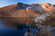 Hiker at Summit Lake, Mount Evans Recreation Area, Arapaho National Forest, Colorado.  (Model Released)