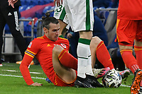 Football - 2020/2021 UEFA Nations League - Group B4 - Wales vs Republic of Ireland - Cardiff City Stadium<br /> <br /> Gareth Bale of Wales brought down by  Jeff Hendrick<br /> in a match played without fans<br /> <br /> COLORSPORT/WINSTON BYNORTH