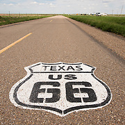 Route 66 sign painted on the road in Texas