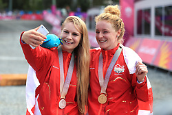 England's Evie Richards (silver) and Annie Last (gold) take a selfie with their medals after the Women's Cross-country at the Nerang Mountain Bike Trails during day eight of the 2018 Commonwealth Games in the Gold Coast, Australia.