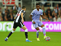 NEWCASTLE UPON TYNE, ENGLAND - SEPTEMBER 17: Junior Firpo of Leeds United  and Miguel Almiron of Newcastle United during the Premier League match between Newcastle United and Leeds United at St. James Park on September 17, 2021 in Newcastle upon Tyne, England. (Photo by MB Media)