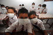 NORTH SULAWESI, INDONESIA - MAY 15: : <br /> <br /> Aftermath Eruption Mount Karangetang Volcano in North Sulawesi<br /> <br /> Students used mask at Siau island aftermath eruption mount Karangetang volcano on May 11, 2015 in North Sulawesi, Indonesia. <br /> Nearly a week passed Since the biggest eruption on Thursday 7 May 2015 Karangetang volcano eruptions of hot clouds and lava. make hundreds of residents in the three mountain hamlets around the place safer displaced and hundreds dead livestock and fruit orchards, nutmeg citizens die. The worst impact is felt villagers Korakora.<br /> For residents in the area of Mount Karangetang known as Api Siau has a value of its own mystique. volcano located in the northern part of North Sulawesi, Indonesia precisely in Siau Island Regency Tagulandang Biaro (Sitaro). Mount Karangetang is one of the most active volcanoes in Indonesia with the eruption of more than 40 times since 1675 as well as many small eruptions that are not documented in historical records. in the notes eruption Karangetang occurred in 1997, 2010 and 2011 that killed three people.<br /> ©Fiqman Sunandar/Exclusivepix Media