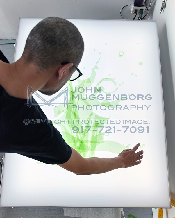 The artist James Thomas working in his Brooklyn studio. Photographed by John Muggenborg.<br /> <br /> http://www.johnmuggenborg.com