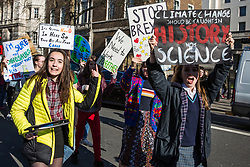 London, UK. 15th February, 2019. Students march along Whitehall during the YouthStrike4Climate for Climate Day which was attended by thousands of young people. Strike events involving schools all over the UK were organised by UK Student Climate Network and the UK Youth Climate Coalition to demand that the Government declare a climate emergency and take positive steps to address the climate crisis, including highlighting the issue as part of the school curriculum, as well as lowering the voting age to 16.
