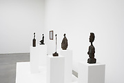 Alberto Giacometti exhibition at the Gagosian Gallery in London, England, United Kingdom. Sculptures within this white art gallery space. Swiss sculptor and painter. His most typical works are emaciated and extremely elongated human forms.