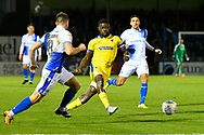 Deji Oshilaja (4) of AFC Wimbledon passes the ball as he is closed down by Ollie Clarke (8) of Bristol Rovers during the EFL Sky Bet League 1 match between Bristol Rovers and AFC Wimbledon at the Memorial Stadium, Bristol, England on 23 October 2018.