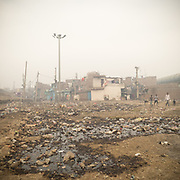 In Bhalswa district, north Delhi, a village is located right below one of the giant open air garbage dump which burns 24/7, creating toxic fumes.