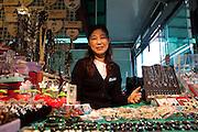 Korean saleswoman in the souvenir shop with jewellery at the Daejin Education Centre / Daejin, South Korea, Republic of Korea, KOR, 08 October 2009.