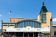 The Stillwell Avenue subway station in Coney Island, terminus of the D, F, N, and Q trains. The pyramid on the roof reflects structures in the former Steeplechase Park, and the BMT tiles on the facade are from the original station.