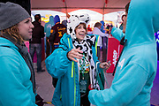 Prize winner Janet Sanchez gives a hug to AARP's Daniela Romero at the AARP Block Party at the Albuquerque International Balloon Fiesta in Albuquerque New Mexico USA on Oct. 8th, 2018.