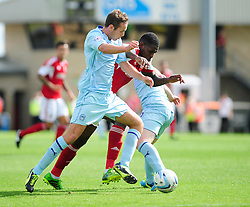 Bristol City's Jay Emmanuel-Thomas attempts to squeeze past to opposing players - Photo mandatory by-line: Dougie Allward/JMP - Tel: Mobile: 07966 386802 11/08/2013 - SPORT - FOOTBALL - Sixfields Stadium - Sixfields Stadium -  Coventry V Bristol City - Sky Bet League One