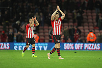 Football - 2018 / 2019 Premier League - Southampton vs. Manchester United<br /> <br /> Southampton's two goalscorers  Stuart Armstrong and Cedric Soares applaud the home fans at the final whistle at St Mary's Stadium Southampton<br /> <br /> COLORSPORT/SHAUN BOGGUST