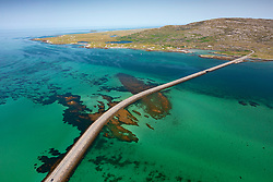 Aerial view from drone of Eriskay causeway linking Islands of South Uist (top) to Eriskay in the Outer Hebrides, Scotland, UK