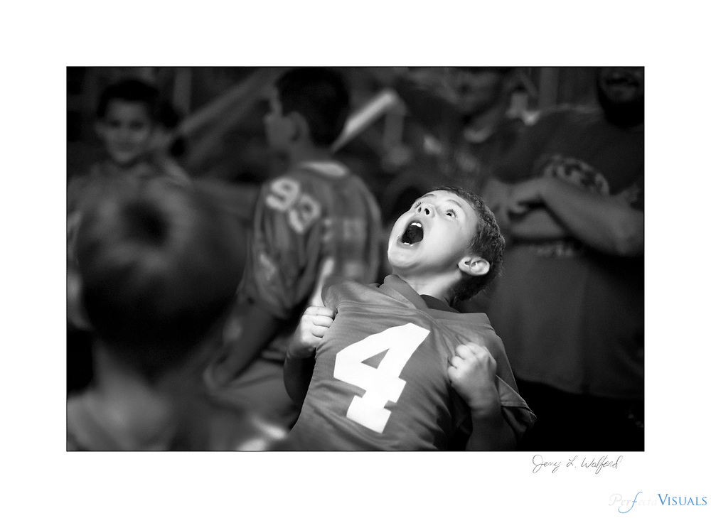"""Recreation football player Shane Stevens mimics Panthers quarterback Cam Newton's """"superman"""" celebration before his team runs onto the field during  half-time festivities celebrating youth football players.<br /> <br /> Randleman defeated High Point Andrews 30-8 at Charles Gregory Stadium, Monday, October 15, 2018, in Randleman, N.C. JERRY WOLFORD  / Perfecta Visuals"""