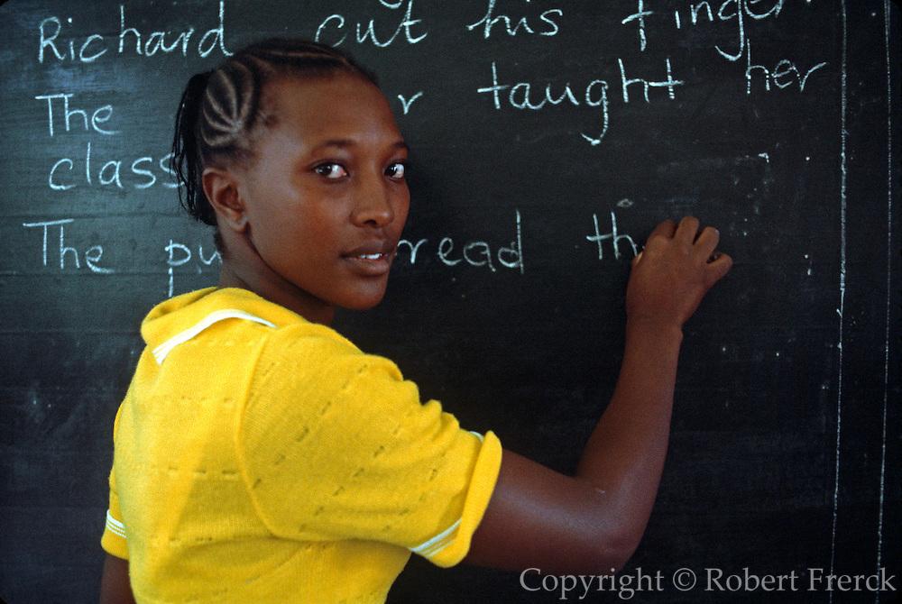 KENYA, EDUCATION NAIROBI; a primary school teacher giving English language instruction at the  blackboard in her classroom in Nairobi