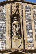 Village parish church of Saint Andrew, Weybread, Suffolk, England, UK statue in porch niche