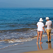 Retired Couple Fishing on Kamaole Beach in Maui, Hawaii