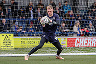 AFC Wimbledon goalkeeper Aaron Ramsdale (35) warming up during the The FA Cup 5th round match between AFC Wimbledon and Millwall at the Cherry Red Records Stadium, Kingston, England on 16 February 2019.